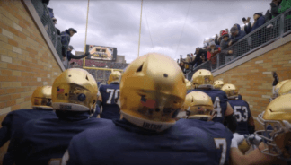 Football game day traditions are steeped in history — as is the Catholic tradition of Mass. Watch how else they're similar!